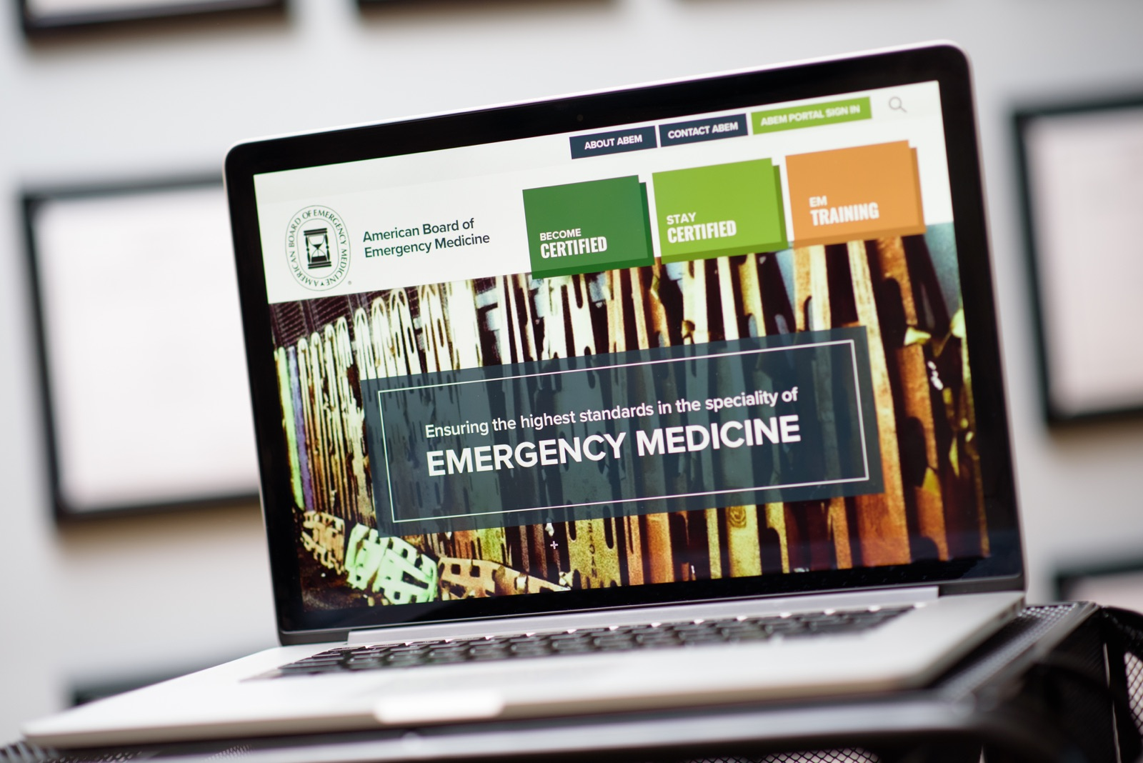 The ABEM website on a laptop