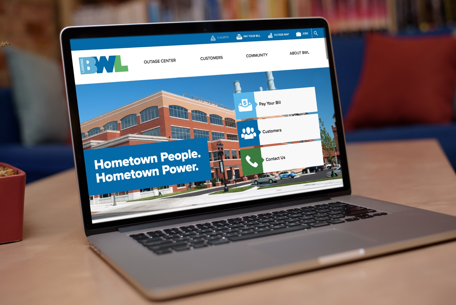 The BWL website homepage on a laptop